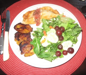 plantains, salad with grapes, empanada with pembre