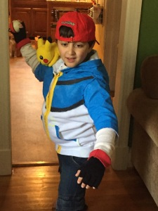 The boy as Ash Ketchum, Pokemon trainer
